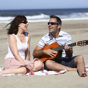 sviranje gitare ženi